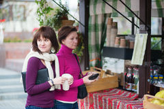 Mother and daughterbuying take away drinks Stock Photos