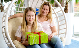 Mother and daughterl with green gift box Stock Image