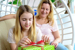 Mother and daughterl with green gift box Stock Images