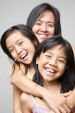 Mother and daughters. Mother hugging her daughters and posing to camera Royalty Free Stock Photos