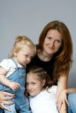 Mother with daughters. Faces of mother and her daughters Royalty Free Stock Image