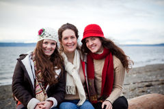 Mother and daughters. A portrait of a mother and her daughters on the beach Royalty Free Stock Photography