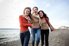 Mother and daughters. A mother having fun with her daughters on the beach Stock Photography