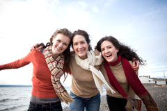 Mother and daughters. A mother having fun with her daughters on the beach Royalty Free Stock Image