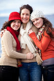 Mother and daughters. A portrait of a mother and her daughters on the beach Stock Photos