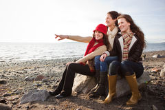 Mother and daughters. A portrait of a mother and her daughters on the beach Royalty Free Stock Photo