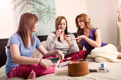 Mother daughters. A shot of a mother spending time with her two teenage daughters Stock Image