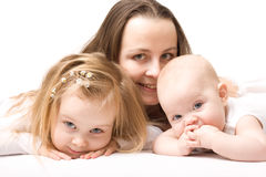 Mother and daughters. Happy Mother with two daughters on white background Royalty Free Stock Photo