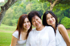 Mother and daughters. Asian senior women and daughters enjoying the outdoors Royalty Free Stock Photography
