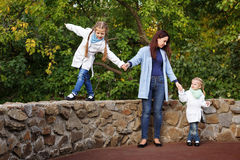 Mother and daughters in autumn park. Royalty Free Stock Photos