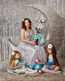 Mother and daughters awaiting Christmas. Stock Images