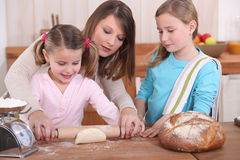 Mother and daughters baking Stock Photo