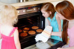 Mother and daughters baking cookies Royalty Free Stock Images