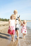 Mother and daughters at beach. Royalty Free Stock Images