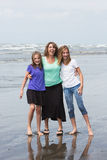 Mother and Daughters at the Beach. A pretty Mom and her two daughters having fun at the beach Stock Images
