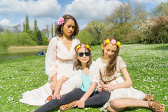 Mother and Daughters bonding in a park Stock Image