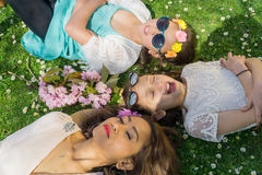 Mother and Daughters bonding in a park Royalty Free Stock Image