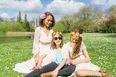 Mother and Daughters bonding in a park Royalty Free Stock Photos