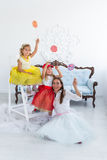 Mother and daughters with candy. In the room Stock Images