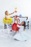 Mother and daughters with candy. In the room Royalty Free Stock Photo
