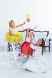 Mother and daughters with candy. In the room Royalty Free Stock Photography