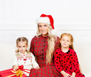 Mother and daughters celebrating Christmas Stock Image