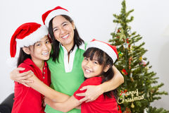 Mother and daughters on Christmas Stock Photography