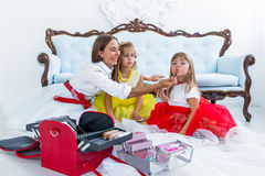 Mother and daughters doing makeup Royalty Free Stock Photos