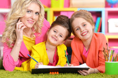 Mother with daughters drawing Royalty Free Stock Photography