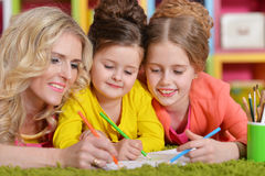 Mother with daughters drawing Stock Images