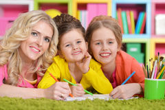 Mother with daughters drawing Royalty Free Stock Photo