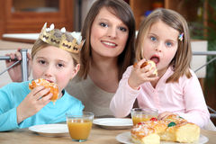 Mother and daughters eating cake Stock Photo