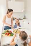 Mother and daughters eating healthy food royalty free stock image