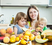 Mother with daughters eating melon Royalty Free Stock Photos