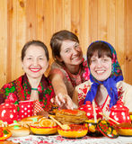 Mother with  daughters eating pancake Royalty Free Stock Photography