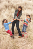 Mother And Daughters Having Fun In Sand Dunes Royalty Free Stock Images