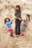 Mother And Daughters Having Fun In Sand Dunes Royalty Free Stock Photos