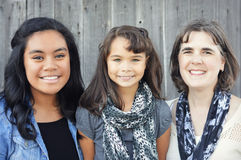 Mother and Daughters. A mother with her multi-racial adopted daughters Royalty Free Stock Images