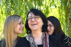 Mother and daughters. Mother and her two grown up daughters having fun Royalty Free Stock Image