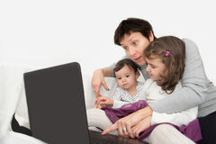 Mother and daughters with a laptop Royalty Free Stock Photography