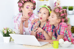 Mother and daughters  with laptop Royalty Free Stock Photo