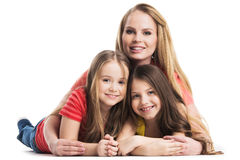 Mother and daughters lying on the floor Stock Photo