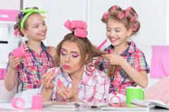 Mother and daughters making hairstyles Stock Photography