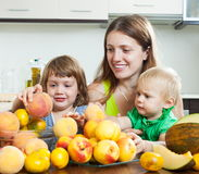 Mother with daughters with melon Stock Photography