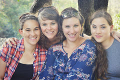 Mother and Daughters. A middle aged mother with her three teen aged daughters Stock Photos