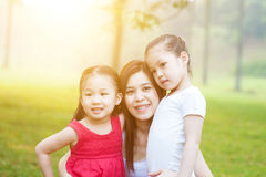 Mother and daughters in the nature. Royalty Free Stock Photography