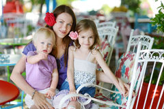 Mother and daughters in outdoor restaurant Stock Photo