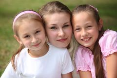 Mother with daughters outdoor in summer Royalty Free Stock Photos