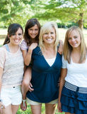 Mother and daughters outside. Mother and three daughters outside smiling Stock Photos