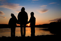 Mother and daughters over Danube under Devin ruins in Slovakia Stock Images